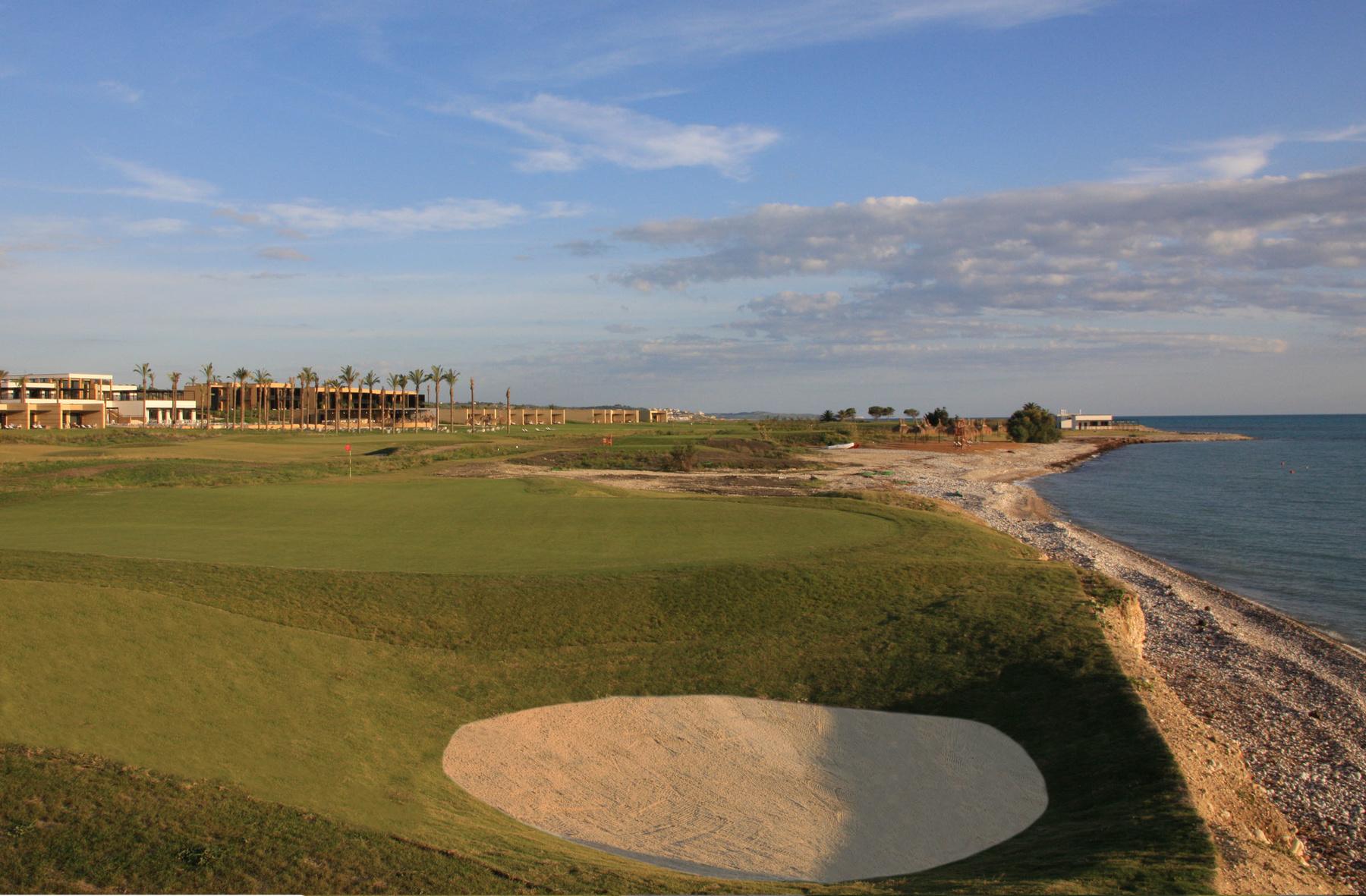 Verdura Golf and Spa Resort 17th green to tee & hotel
