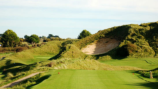 St Enodoc (Church course) 6th hole with Himalayas bunker in the foreground and green to the left