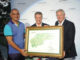Colin Montgomerie (right) presents signed artwork of his signature Montgomerie Maxx Royal Course to CEO of the ETS Group, Mehmet Ersoy (left) with Ahmet Agaoglu, President of the Turkish Golf Federation (centre)