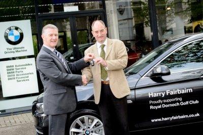 Iain Clark (left) hands the keys to Neil Hampton