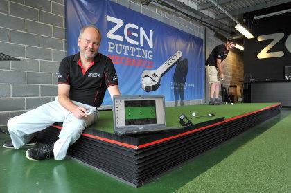 Nick Middleton, Managing Director of Zen Oracle, tests his robotic putting green Sept 2015 (landscape)
