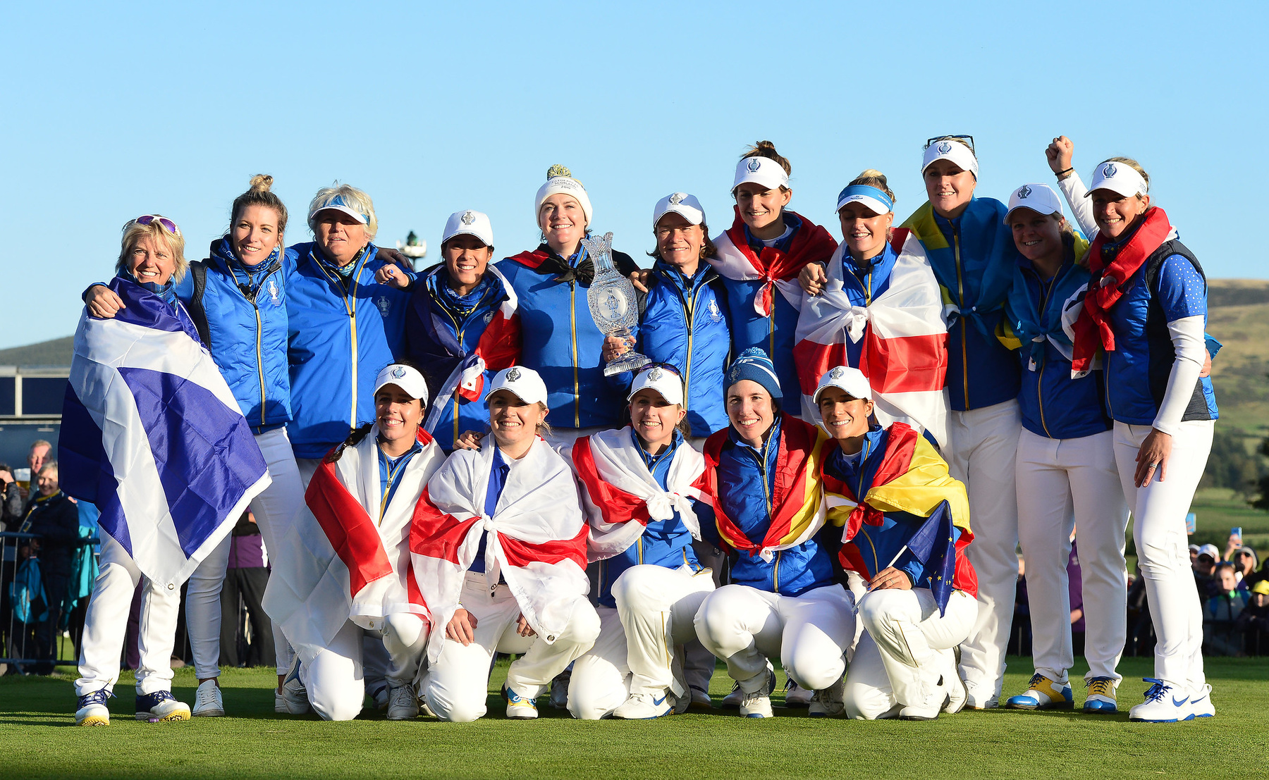 The European team celebrate together as they win the Solheim Cup