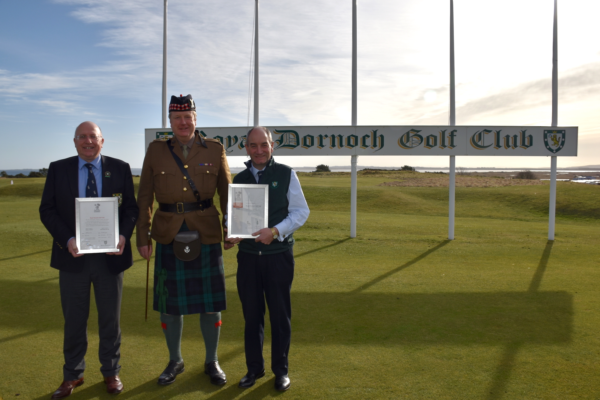 Royal Dornoch captain Rob Murray, Major Alec Rose, Battalion second in command, 7 SCOTS. and club general manager Neil Hampton